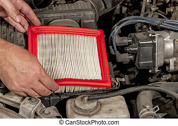 Automobile air filter replacement by machanic