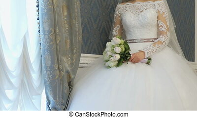 Bride stands next to window during photo session - The bride...