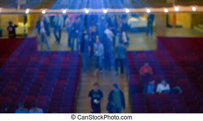 People Walking in the Cinema Below Projectors Rays