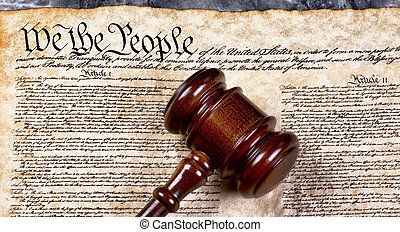 We the People - Wooden gavel on top of American Bill of...