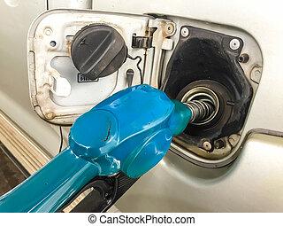 refuel - Fuel pump nozzle in the fuel tank of a car, refuel