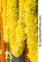 Flower garlands adore a shop front in India