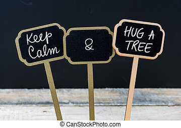 Keep Calm and Hug A Tree message written with chalk on mini blackboard labels