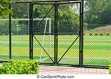 soccer field being locked with padlock