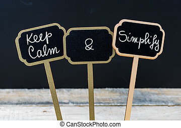 Keep Calm and Simplify message written with chalk on mini...