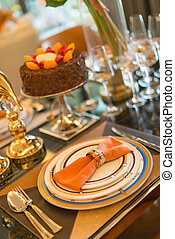 luxury table setting with a birthday cake selective focus