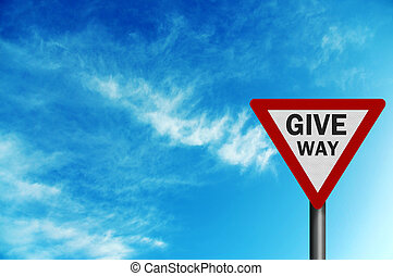 Photo realistic \' give way\' sign, against a bright blue sky