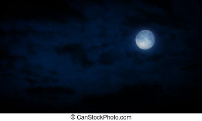 Full Moon With Clouds Passing - Large full moon in the night...