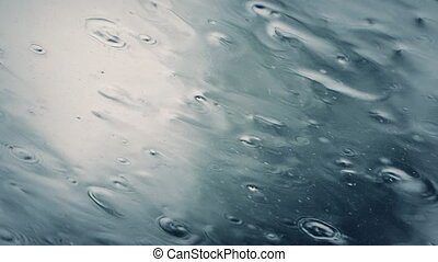Heavy Rain On Skylight - Macro shot of rain hitting sky...