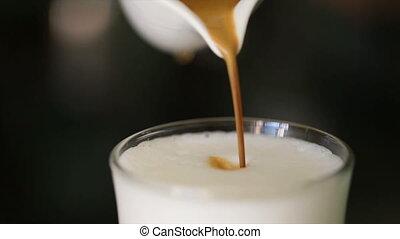 Barista preparing cappuccinno / latte art coffee in to white cup