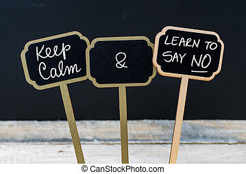Keep Calm and Learn To Say NO message written with chalk on...