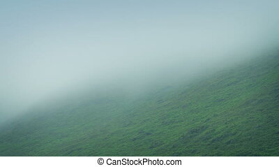 Mist Moving Over Mountain - Mist rolls over rugged...
