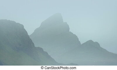 Jagged Misty Landscape With Birds - Dramatic mountainous...