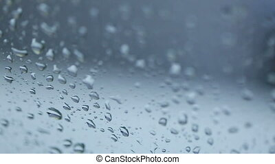 Rain Rain, Go Away. Large rain drops strike a window pane...