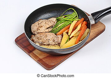 Cooking pork steak with mixed veget