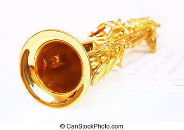 Musical notes and saxophone on a white background