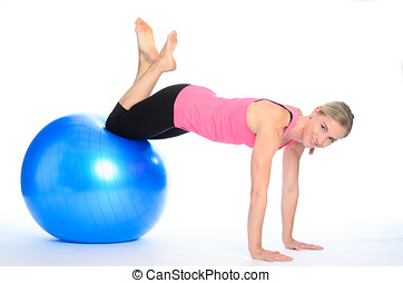 Athletic woman doing pilates exercises balancing with her...