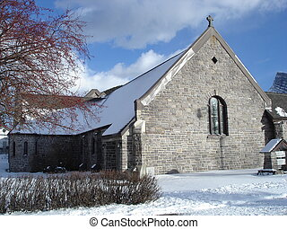 Side view of an old stone church - Winter time scenic of the...