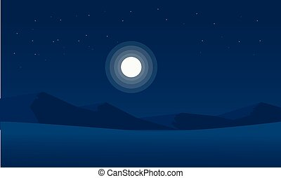 Silhouette of mountain desert with moon
