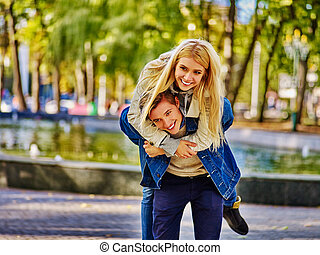 young people spend time outdoors in autumn park. - Young...
