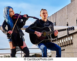 Buskers with girl violinist on roof. - Couple of buskers...