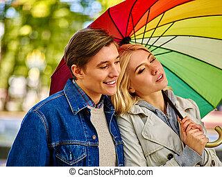 Couple in love on date under umbrella after rain. - Happy...