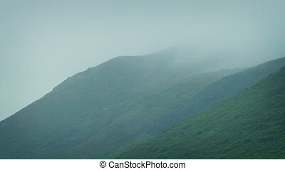 Mist Rolling Over Mountains - Heavy mist rolling across bare...