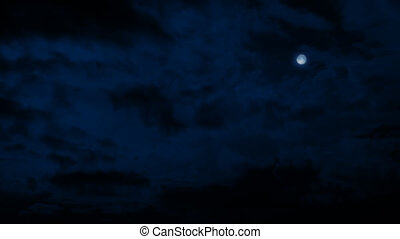 Moon In Night Sky With Clouds - Wide shot of night sky with...