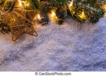 Christmas fir tree with lights and star on snow in dark,...