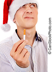 Young Man with a Cigarette - Pensive Young Man in Santa Hat...