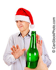 Young Man refuse a Beer - Young Man in Santa Hat refuse a...