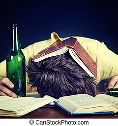 Student sleep with a Beer - Toned Photo of Student with a...