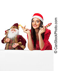 girl in red dress with candy and a Santa doll