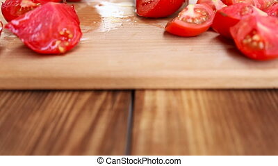 girl cuts tomatoes closeup - girl cut tomatoes with a large...