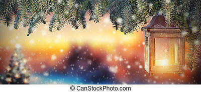 Christmas lantern in sunset light. Blur snowy background....