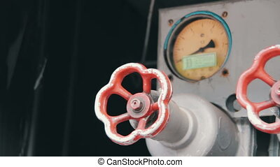 Red Industrial Tap Water and Pressure Indicators on the Fire...