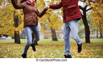 happy young couple having fun in autumn park - love,...