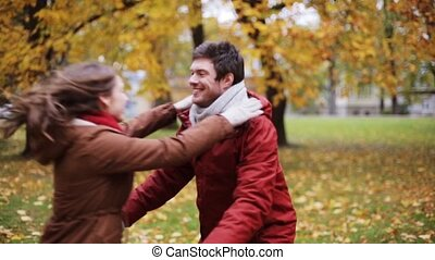 happy young couple meeting in autumn park - love,...