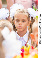 First grader tired of classmates in the crowd at the first...