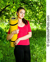 girl holding yellow sport and going to the yoga class - girl...