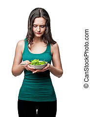 beautiful sporty woman with lettuce