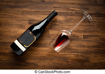 Bottle of wine and glass on old wood background. - a bottle...