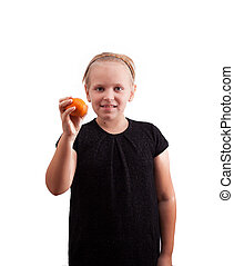 Girl with tangerine in hand - Beautiful blonde girl with...