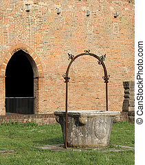 well to collect rain water in the Pomposa Abbey in Italy -...