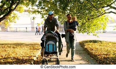 Family with kids walking through the autumn park. 3840x2160