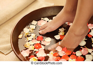 Foot spa and aromatherapy - Feet dipped into spa &...