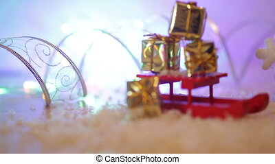 Christmas background with red snowflakes toy sled.