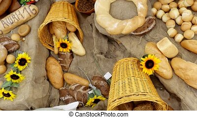 Composition of rye breads, bag of flour and baguettes with...