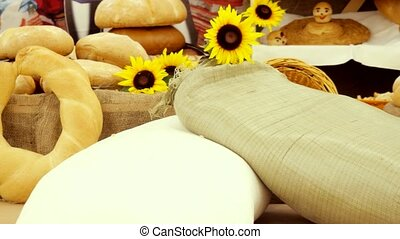 Composition of rye breads, bag of flour, wicker basket and...