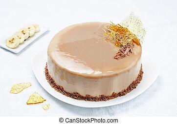 Banana caramel mousse cake with milk chocolate glaze....